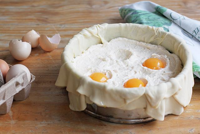 making torta pasqualina - ricotta and egg layer